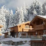 INN's Holz Chalet - Hüttendorf im Winter