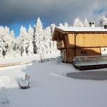 INN's Holz - Chalet im Winter