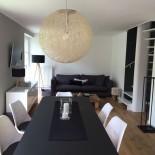 Hues am Wall: Wohnzimmer mit Esstisch; Bild: Hues am Wall